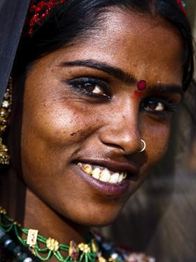 Portrait of Woman in Traditional Dress at the Pushkar Camel Fair by Kimberley Coole
