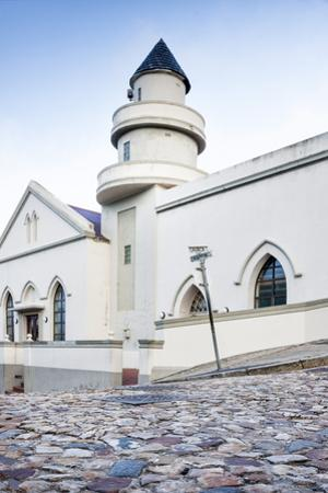 Cobblestones and the Exterior of a Church in Bo-Kaap Residential District by Kimberly Walker