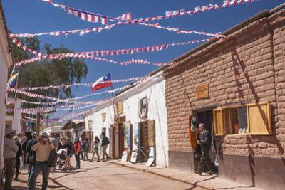 Locals Celebrating September 18 Independence Day Holiday with Bbq, Flags and Streamers, San Pedro by Kimberly Walker