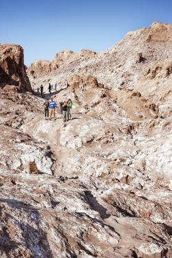 Tourists Climbing over the Top of Chulacao Caves, Moon Valley, Atacama Desert by Kimberly Walker