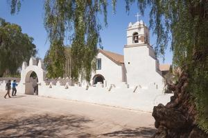 Two Men Approach the White Adobe Iglesia San Pedro Church, San Pedro, Chile, South America by Kimberly Walker