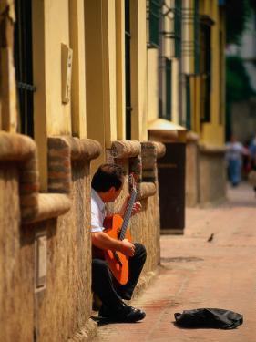 Guitarist Along Callejon Del Agua, Seville, Spain by Kindra Clineff