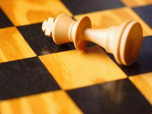King chess piece lying on chessboard