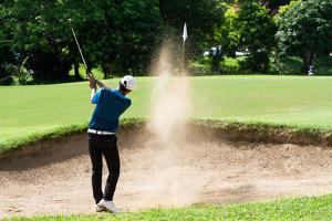 Thai Young Man Golf Player in Action Swing in Sand Pit during Practice before Golf Tournament at Go by Kitzero