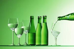 Pouring Mineral Water into Glass by Klaus Arras