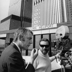 KLUTE, 1971 directed by ALAN PAKULA On the set, Donald Sutherland and Alan Pakula (b/w photo)