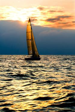 Sports Yacht in the Sea at Sunset. by Knevich