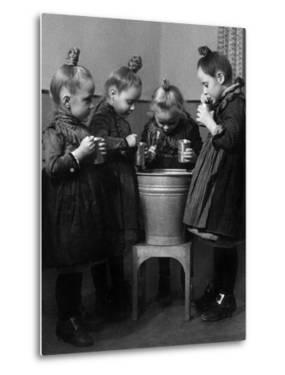 Little Girls Brushing their Teeth by Knorr & Hirth