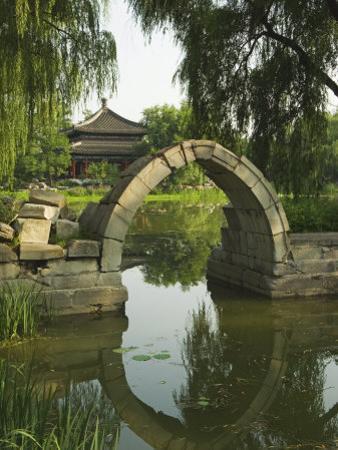 An Arched Bridge at Yuanmingyuan, Beijing, China by Kober Christian
