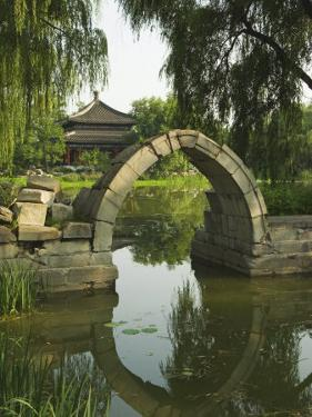 An Arched Bridge at Yuanmingyuan, Beijing, China by Kober Christian