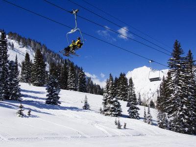 Chair Lift Carries Skiers at Alta, Alta Ski Resort, Salt Lake City, Utah, USA