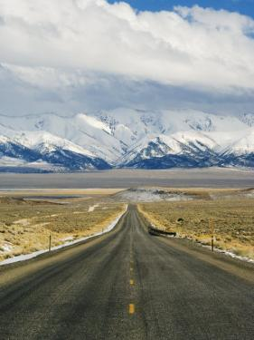 Never Ending Straight Road on US Route 50, the Loneliest Road in America, Nevada, USA by Kober Christian