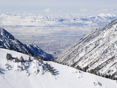 Salt Lake Valley and Fresh Powder Tracks at Alta, Alta Ski Resort, Salt Lake City, Utah, USA