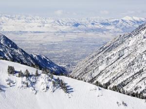 Salt Lake Valley and Fresh Powder Tracks at Alta, Alta Ski Resort, Salt Lake City, Utah, USA by Kober Christian