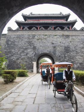 Tourist Rickshaw at a City Gate Watch Tower, Qufu City, Shandong Province, China by Kober Christian