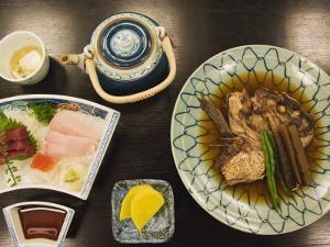 Traditional Japanese Meal of Sushi and Fish Head, Tokyo, Honshu Island, Japan by Kober Christian