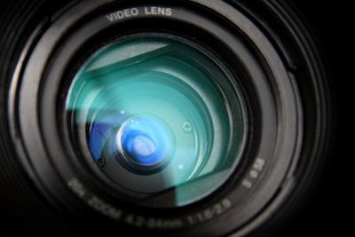 Close-Up View on Black Video Camera Lens by Kokhanchikov