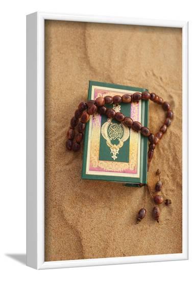 Koran and prayer beads in sand, Dubai, United Arab Emirates-Godong-Framed Photographic Print