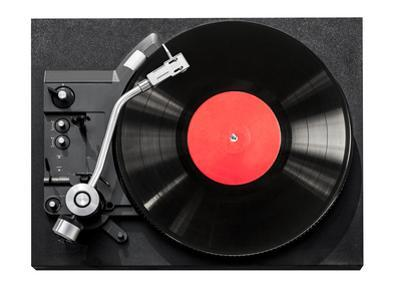 Top View of Old Fashioned Turntable Playing by kornienko