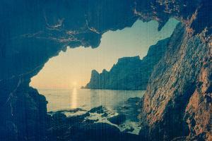 Seascape. View from the Grotto at Beautiful Sunset. Rocks at Sea. Peninsula Crimea, the Black Sea. by Kotenko