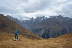 Tourists in the Mountains Standing on a Rock and Looking over the Valley. Overcast. Main Caucasian by Kotenko