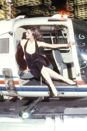 Model Posed at the Door of a Helicopter in a Short Bare Dress by Chester Weinberg