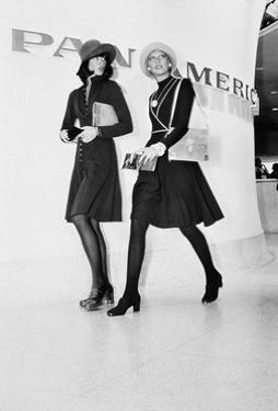 Two Models Walking in Front of a Pan American Airlines Sign by Kourken Pakchanian