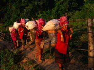 Akha Women Carrying Shopping Home, Muang Sing, Laos by Kraig Lieb