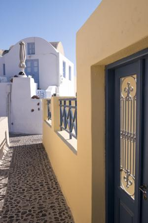 A Colorful Building with a Narrow Path in the Picturesque Town of Oia, Santorini