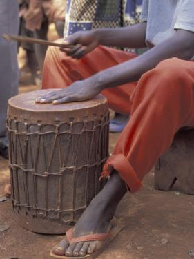 Playing a Congolese Drum in a Congolese Refugee Camp, Tanzania by Kristin Mosher