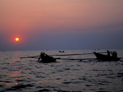 Silhouetted Boats on Lake Tanganyika, Tanzania
