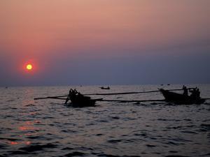 Silhouetted Boats on Lake Tanganyika, Tanzania by Kristin Mosher
