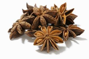 Several Star Anise on White Background by Kröger and Gross