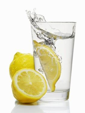 A Wedge of Lemon Falling into a Glass of Water by Kröger & Gross