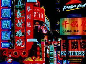 Neon Signs Along Nanjing Donglu Shopping Street, Shanghai, China by Krzysztof Dydynski