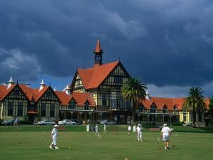 Playing Croquet in Front of Former Bath House, Now Museum of Art and History, Rotorua, New Zealand by Krzysztof Dydynski