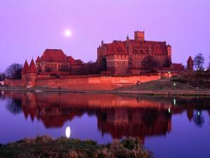 Teutonic Castle of Malbork at Sunset, Malbork, Poland by Krzysztof Dydynski