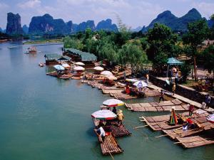 Tourists Raft Landing Site on Yukong River Near Yangshuo by Krzysztof Dydynski