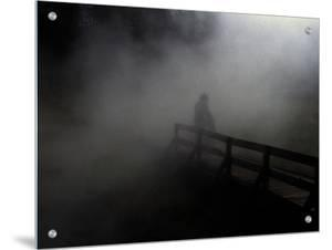 Adult and Children on Foggy Pier by Krzysztof Rost