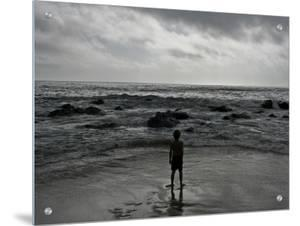Child Standing at the Edge of Tide by Krzysztof Rost