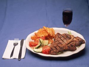 T-Bone Steak Dinner with Wine by Kurt Freundlinger