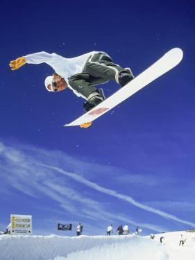 Airborne Snow Boarder by Kurt Olesek