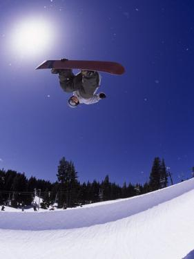 Airborne Snowboarder in Half Pipe Position by Kurt Olesek