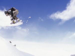 Man on Snowboard Jumping by Kurt Olesek