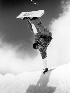 Snowboarder Doing a Handstand by Kurt Olesek
