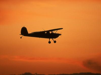 Silhouette of Small Airplane in Flight by Kyle Krause