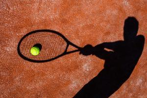 Shadow Of A Tennis Player In Action On A Tennis Court (Conceptual Image With A Tennis Ball by l i g h t p o e t