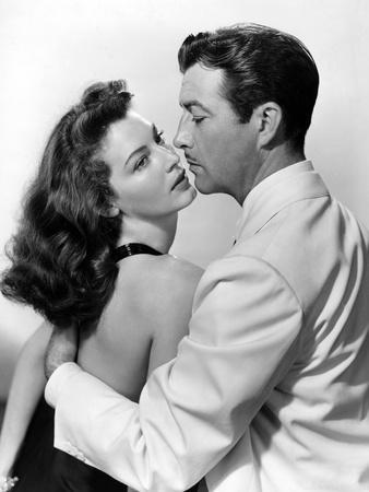 https://imgc.allpostersimages.com/img/posters/l-ile-au-complot-the-bribe-by-robertleonard-with-ava-gardner-and-robert-taylor-1949-b-w-photo_u-L-Q1C1J0W0.jpg?artPerspective=n