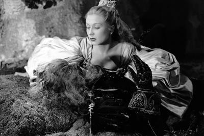 https://imgc.allpostersimages.com/img/posters/la-belle-and-la-bete-by-jeancocteau-with-josette-day-and-jean-marais-1946-b-w-photo_u-L-Q1C2Z5V0.jpg?artPerspective=n