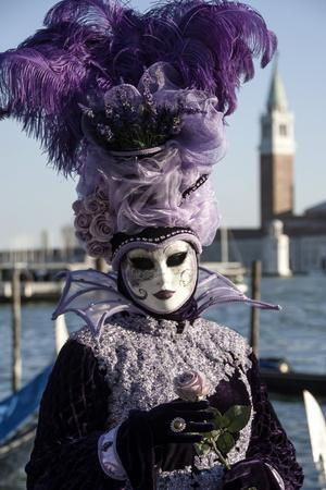 https://imgc.allpostersimages.com/img/posters/lady-in-black-and-purple-mask-and-feathered-hat-venice-carnival-venice-veneto-italy_u-L-PWFBOK0.jpg?artPerspective=n